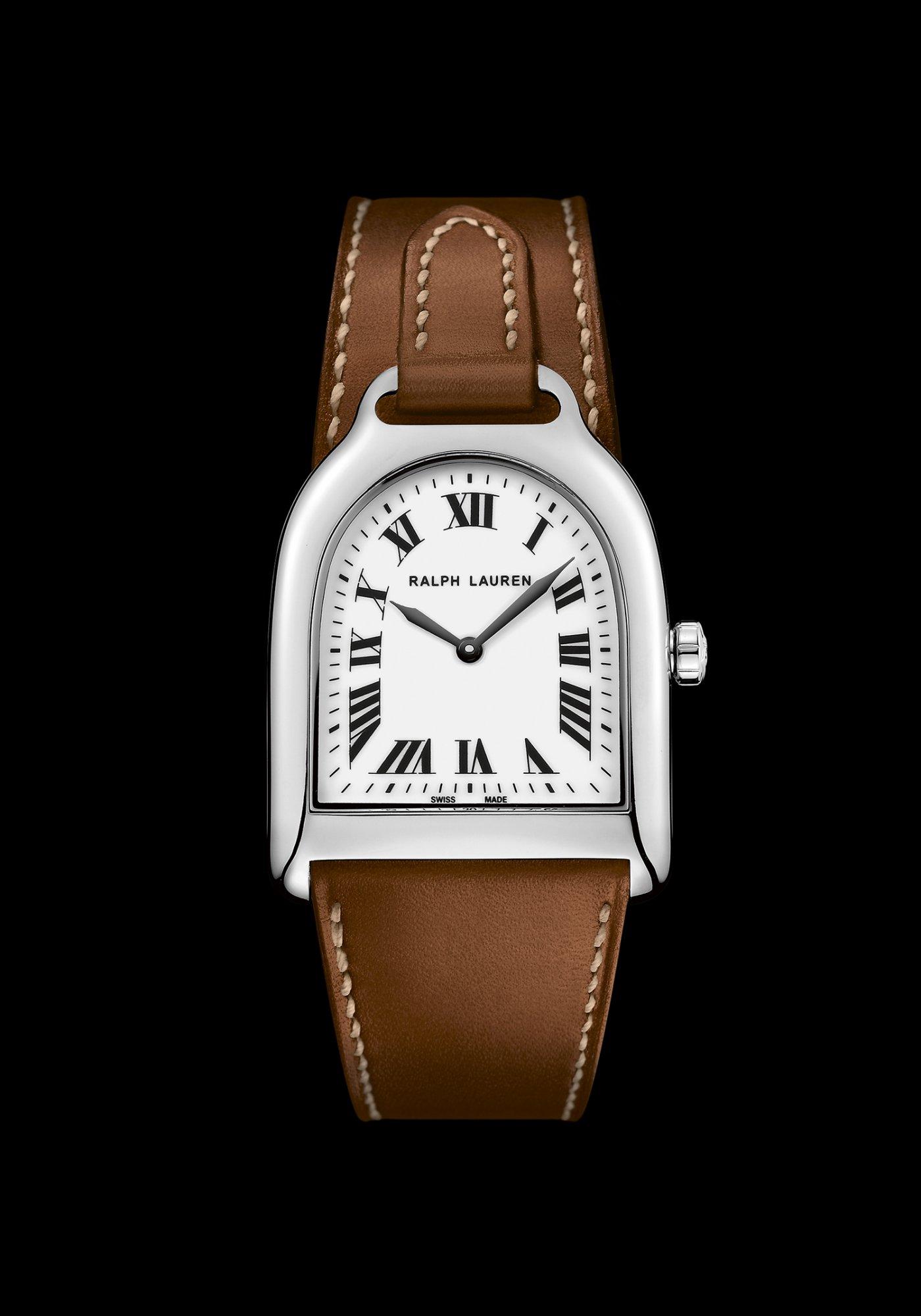 Dotée d un mouvement Quartz Suisse RL057 et décoré de côtes de Genève  verticales, la Stirrup Petite est disponible avec un bracelet en veau brun  contrasté ... 92bbc15552a